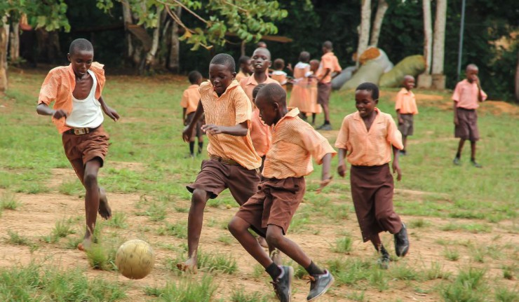kids playing football and waiting for football worldcup